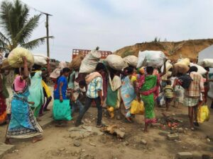 Rescued families gather their belongings