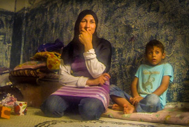 Displaced Syrian mother and child