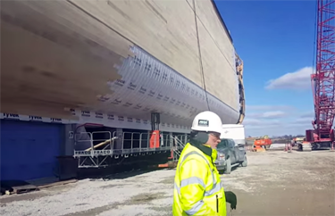 Ken Ham walks around exterior of ark