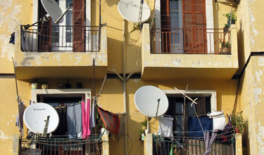 satellite dishes proliferate in the Middle East