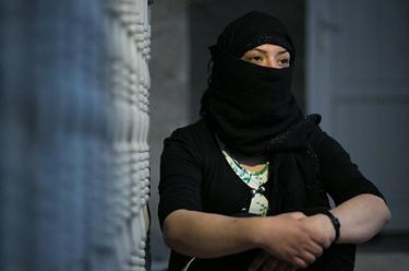 Khalida with arms folded