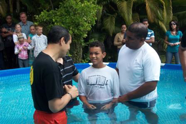 Samuel (right) involved in a baptism