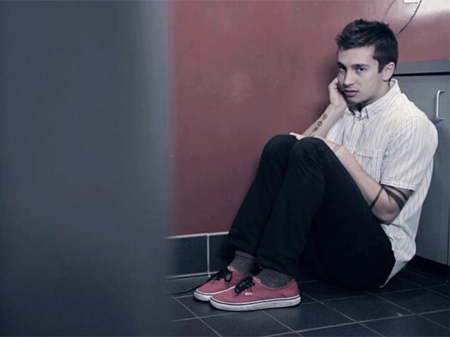 "Tyler Joseph on the video ""Car Radio."""