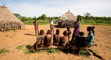 Berki speaking to villagers