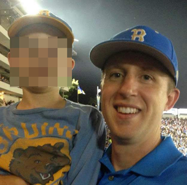 Klug with his son at UCLA game