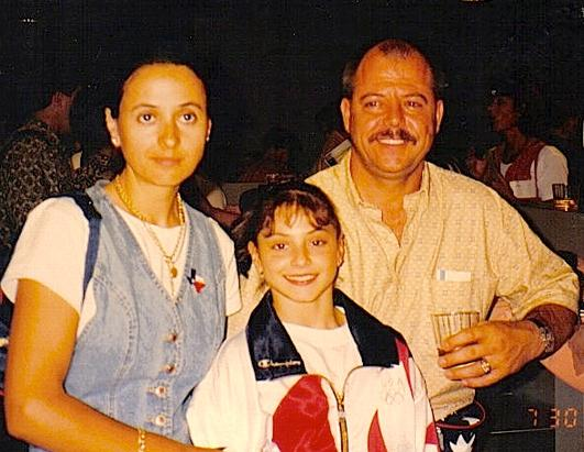 Little Dominique with her dad and mom.