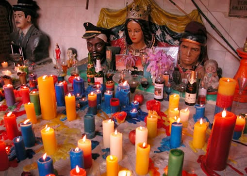 Candles in santeria practices. Image from Google.