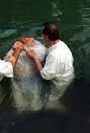 Pastor Paul baptizes one of the new Muslim converts to Christianity