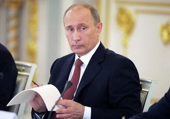 Vladimir Putin signing anti-missionary law