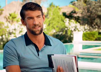 """Michael Phelps holding copy of """"The Purpose Driven Life""""."""