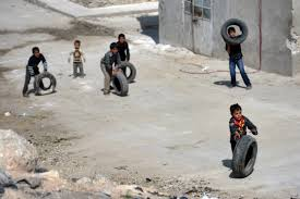 Kids from Aleppo bringing tires.