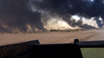 ISIS tactics include setting oil fires to ward off bombers