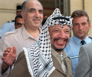 Palestine Liberation Organisation (PLO) chairman Yasser Arafat (C), surrounded by his advisers, including Salah Khalaf aka Abu Iyad (behind Arafat, smiling), addresses media 29 August 1990 in Paris after his meeting with French Premier Rocard. Abu Iyad, who was born to a middle-class family in Jaffa in 1933, was later put in charge of security and intelligence, including counter-intelligence, of PLO. Abu Iyad was assassinated in January 1991 by what PLO sources identified as a bodyguard of the PLO leader Abu al-Hawl, who was also assassinated that night. Reports suggested that the gunman belonged to Abu Nidal's organization, although the PLO has never investigated the assassination. AFP PHOTO PIERRE GUILLAUD (Photo credit should read PIERRE GUILLAUD/AFP/Getty Images)