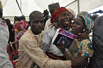 Parents overcome with emotion at release of their daughter from captivity