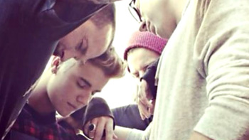 Bieber praying with friends