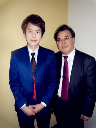Kyuhyun and his dad today.